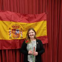 Abigail Boersma posing in front of Spanish flag